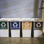 Cztery kosze na odpady sortowane - szkło, papier, metale i mieszane